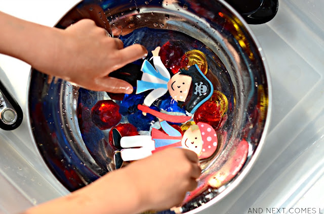 Pirate themed fine motor water play idea for kids from And Next Comes L