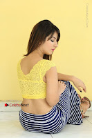 Cute Telugu Actress Shunaya Solanki High Definition Spicy Pos in Yellow Top and Skirt  0375.JPG