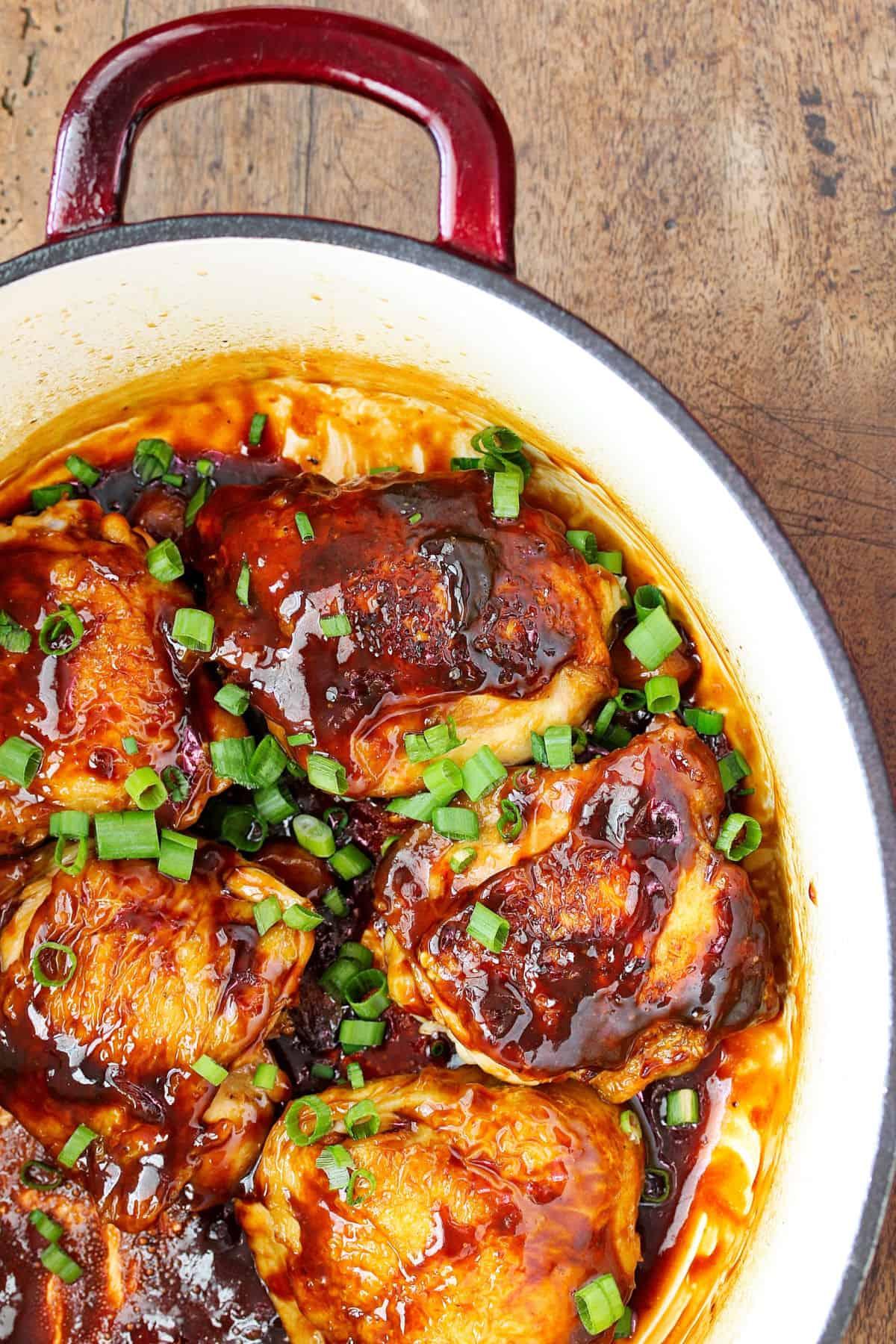 Garlic and Ginger Caramel Chicken Thighs in pot.