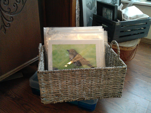 My Giclee art prints packaged and displayed in a rustic basket.