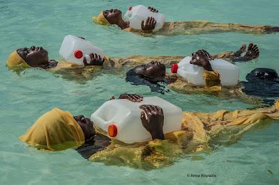 © Anna Boyiazis color photograph of young women learning to swim in  Indian Ocean off of Muyuni, Zanzibar