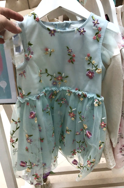 A pale blue organza dress with embroided flowers from the All Dressed Up Boots mini club collection