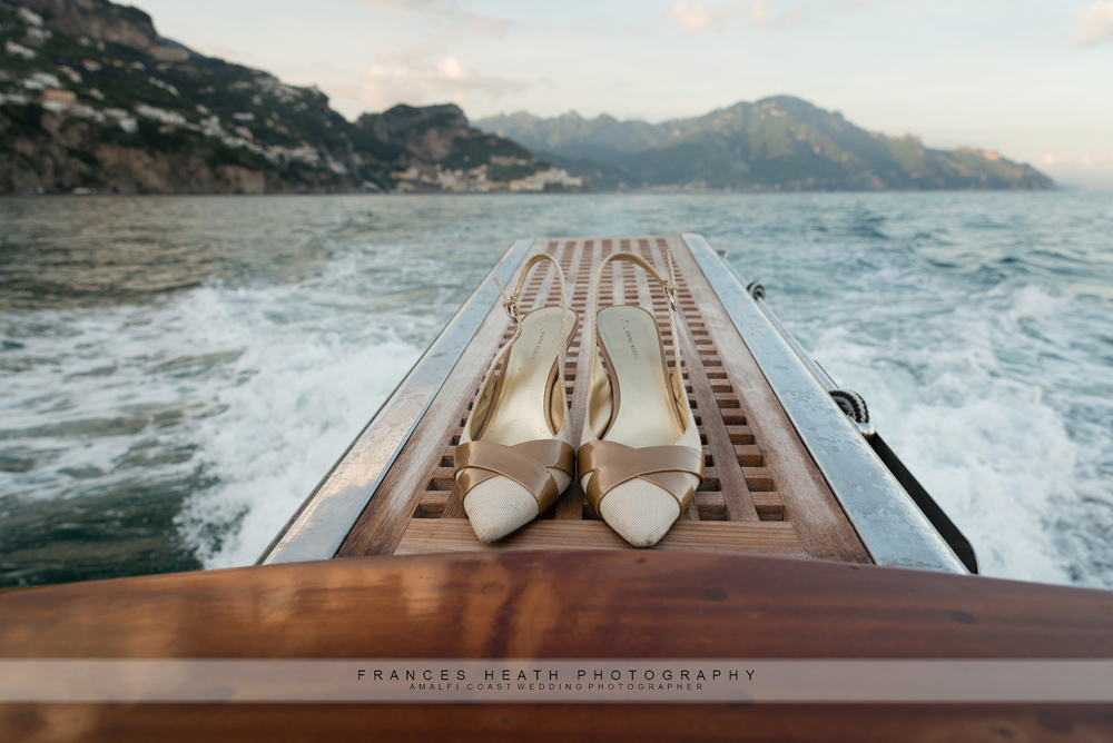 Amalfi coast view with bride's shoes