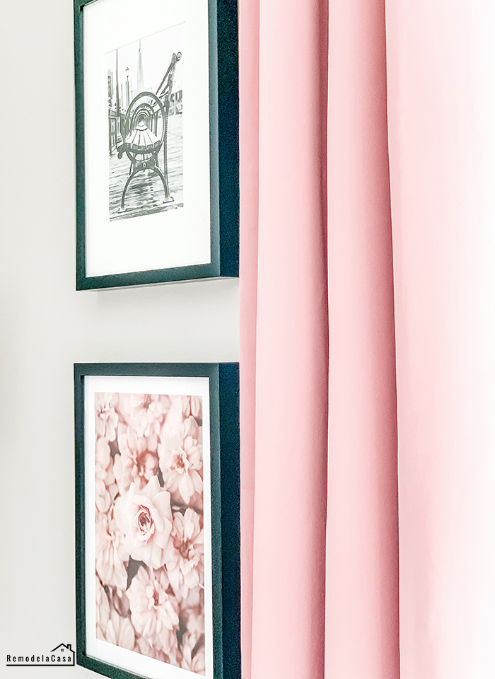 Paris wall art and pink curtains