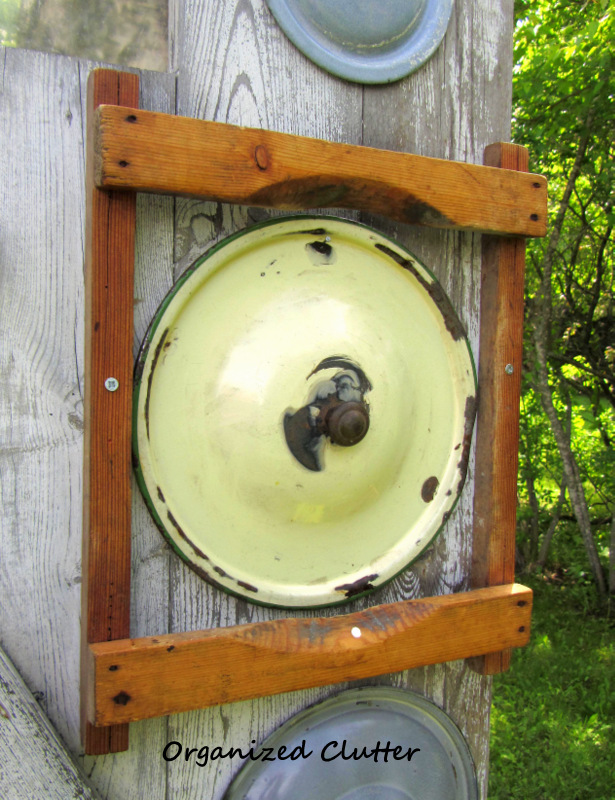 Garden Junk Decor: Lids on a Barn Door www.organizedclutterqueen.blogspot.com