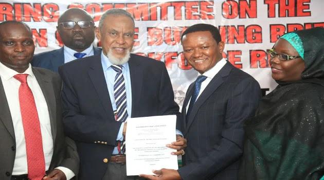 Dr Alfred Mutua with BBI taskforce chairman Yusuf Hajji. PHOTO | CAPITAL