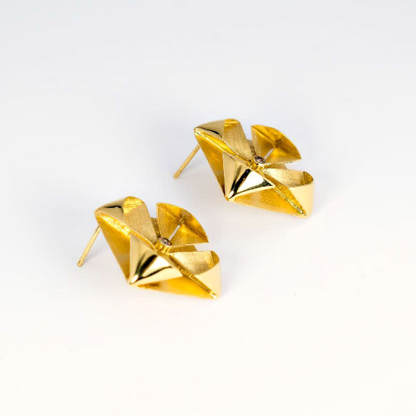 golden metal, hand folded floral earrings with zirconia center