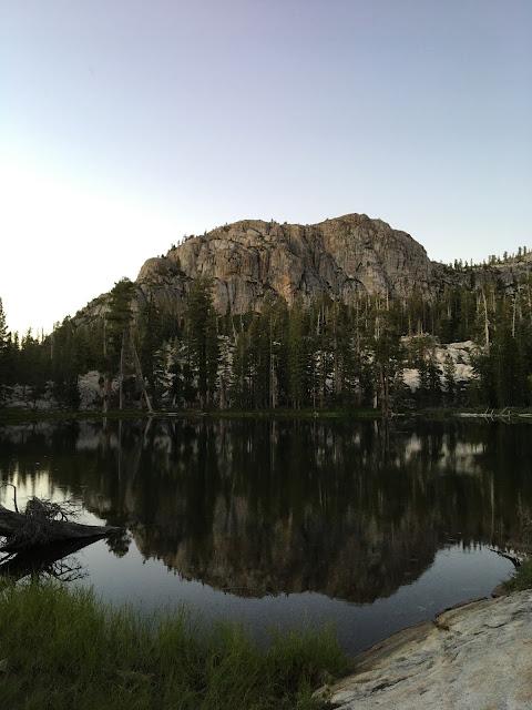 granite crag over lake in evening light