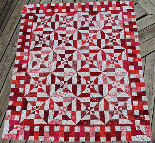 Red Hot Flash Quilt quilted by Sarah Lynn, The Pattern Designed by Debby Kratovil for Blank Quilting