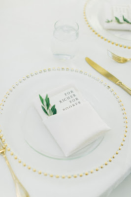 menu card with gold chargers and flatware