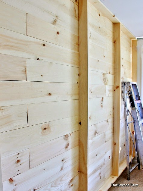 DIY Wood paneled wall with shelves