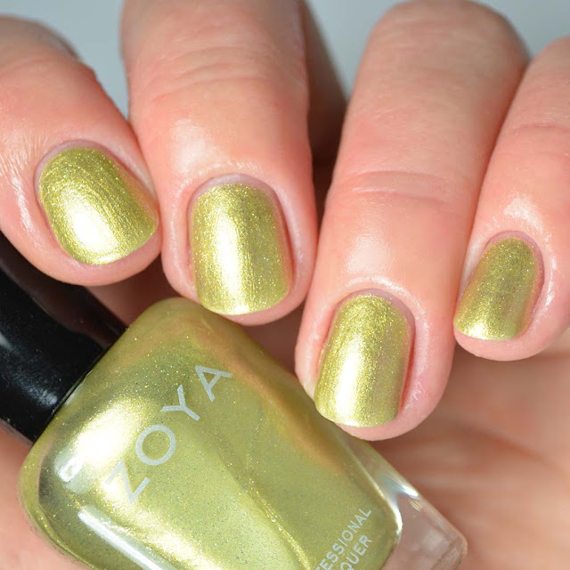 light green nail polish swatch four fingers