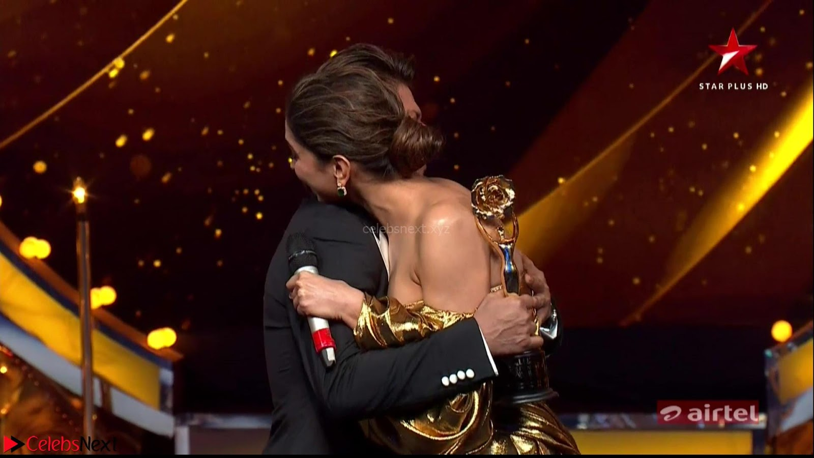 Deepika Padukone in Glittering Deep neck Golden Gown at  Lux Golden Rose Awards 2018 CelebsNext Exclusive