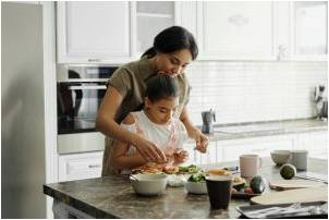 A mother and a daughter preparing a healthy version of their favorite foods