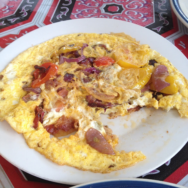 Bacon, tomato, and onion omelet at Ging-ging's Restaurant in Malapascua Island Daanbantayan Cebu Philippines