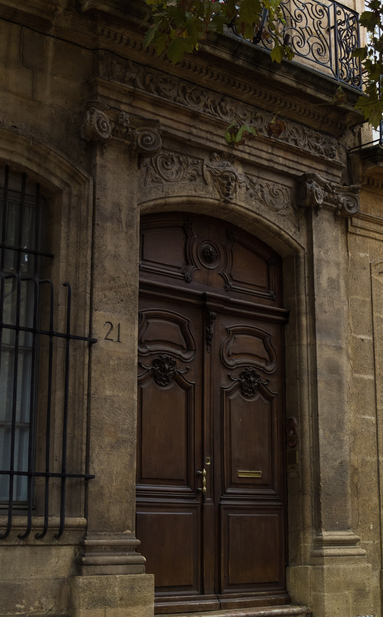 Tall timber doorway on Cours Mirabeau in Aix-en-Provence, Southern France.
