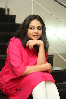 Actress Arundathi Nair Stills in Red Chididar at Bethaludu Success Meet  0100.JPG