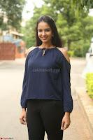 Poojita Super Cute Smile in Blue Top black Trousers at Darsakudu press meet ~ Celebrities Galleries 030.JPG