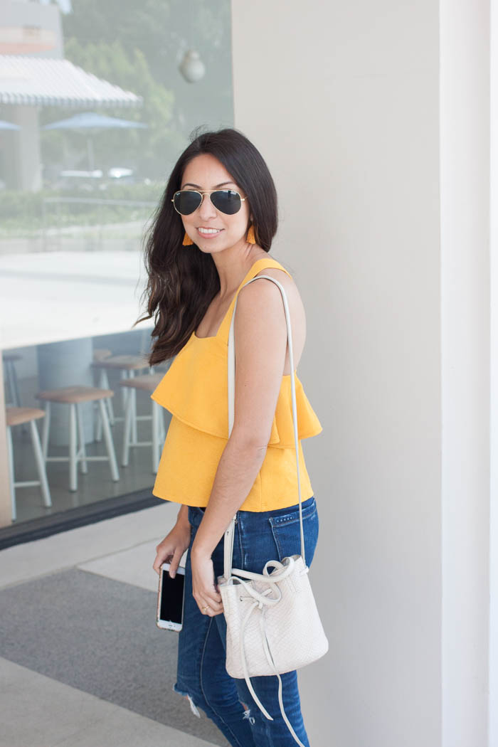 cute yellow tassel earrings and flowy top