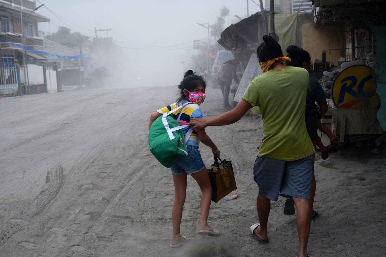 Residents flee their homes in Lemery, Batangas due to ashfall
