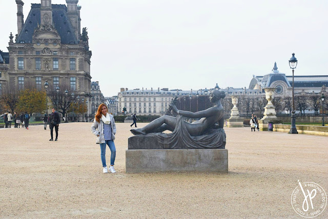woman near massive statue of reclining woman