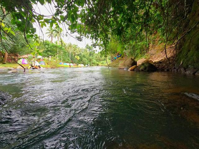 nakatagong paraiso river flowing camping