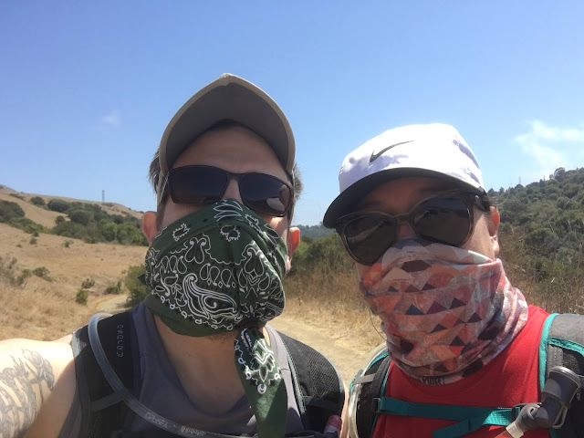Eric and Amber wearing masks on a hiking trail
