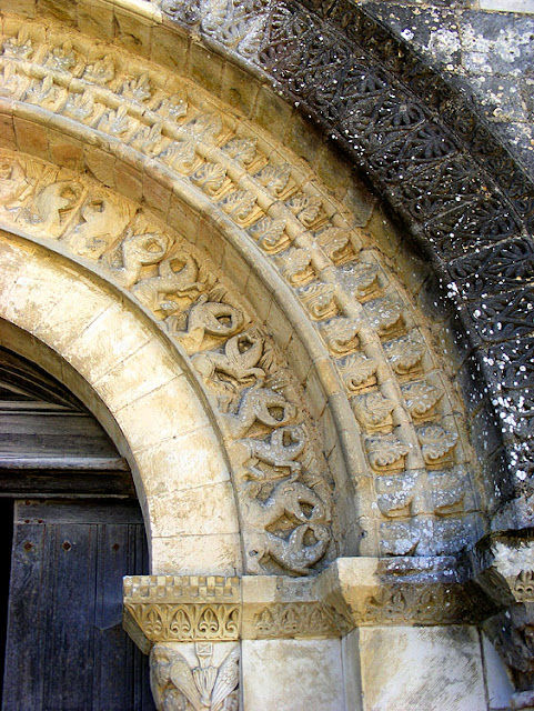 Detail of the carving on the south entrance of the Church of Saint Maurice la Clouere. France. Photographed by Susan Walter. Tour the Loire Valley with a classic car and a private guide.
