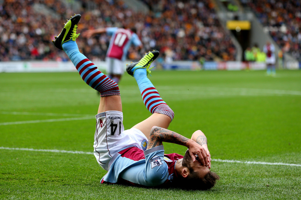 Antonio Luna of Aston Villa reacts after a missed chance on goal during the Barclays Premier League match between Hull City and Aston Villa at KC Stadium on October 5, 2013 in Hull, England