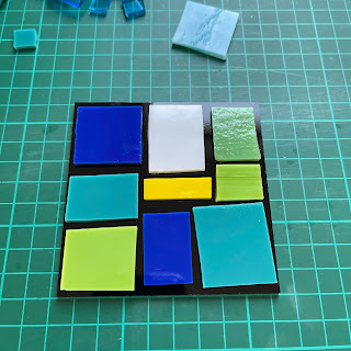 Stacked glass coaster with first layer of stacks