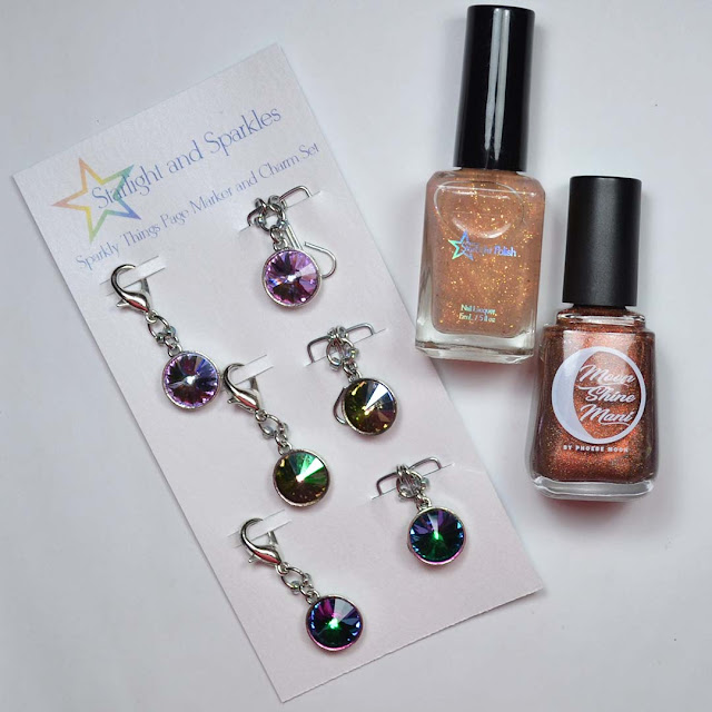 nail polish and charms arranged in a flat lay
