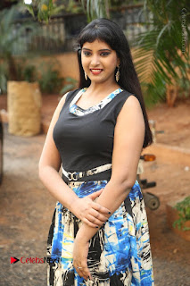 Actress Model Poorni Stills in Floral Long Dress at Silk India Expo Launch  0014.JPG