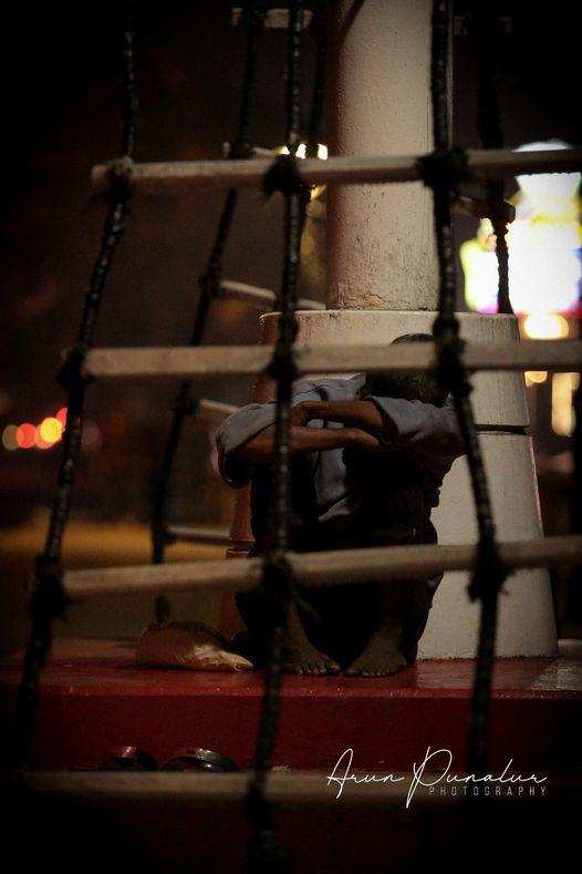 Man sleeping on the street, photo by Arun Punalur