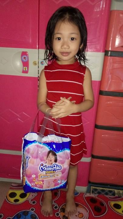 My Lovely Daughter Holding A Mamypoko Extra Soft Diaper Pants For Girls Xl, 12S-9406