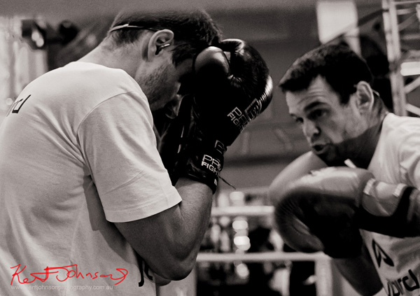 Two men boxing at the Jaybird Freedom launch in Kings Cross Sydney. Photo by Kent Johnson for Street Fashion Sydney.
