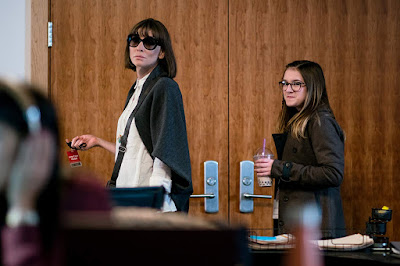 Movie still for the 2019 film Where'd You Go Bernadette where Cate Blanchett, wearing large frame sunglasses, walks out of her husbands office with her daughter, played by Emma Nelson