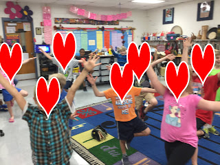 First grade students doing yoga poses from Yoga Pretzels pose cards