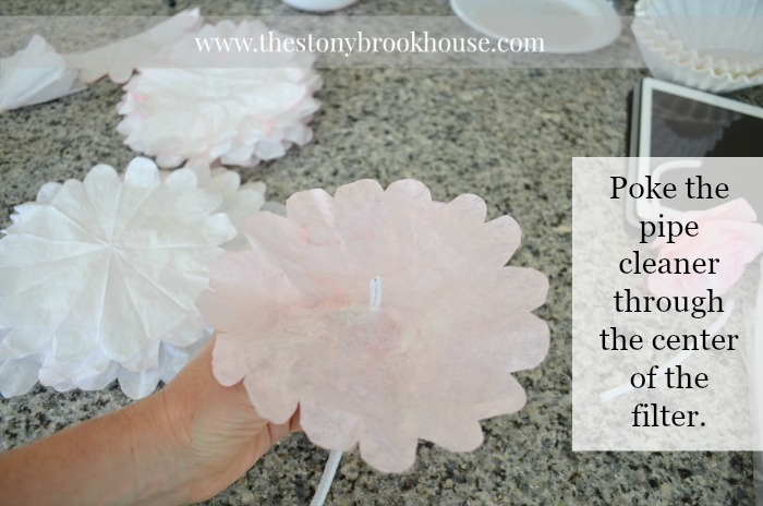 Poke the pipe cleaner through the coffee filter