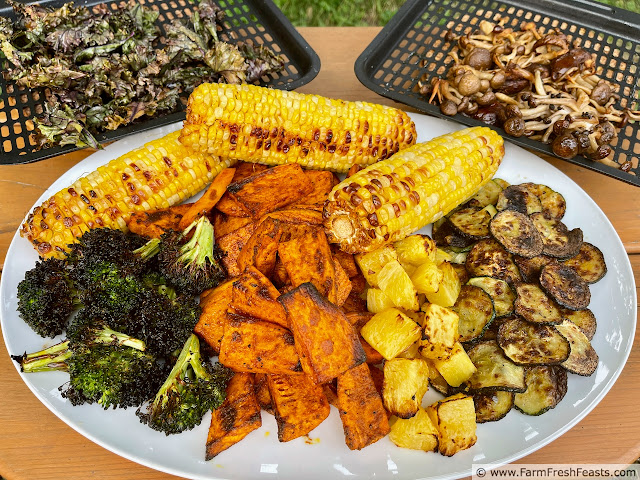 image of platter of corn, broccoli, zucchini, pineapple, kale sweet potatoes, mushrooms all cooked in an air fryer