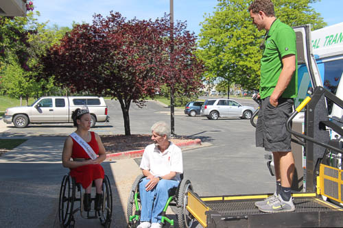 Miss Wheelchair Utah and others talk outside an accessible van