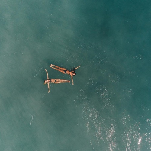 Two girls swimming in the ocean