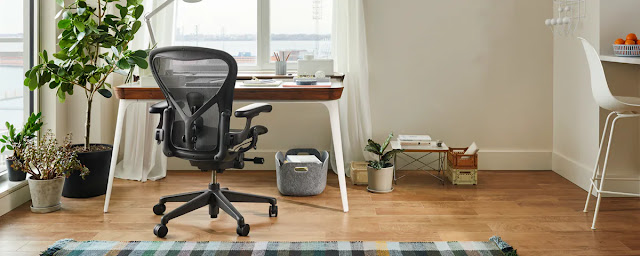 herman miller ergonomic chair with desk setup and monitor
