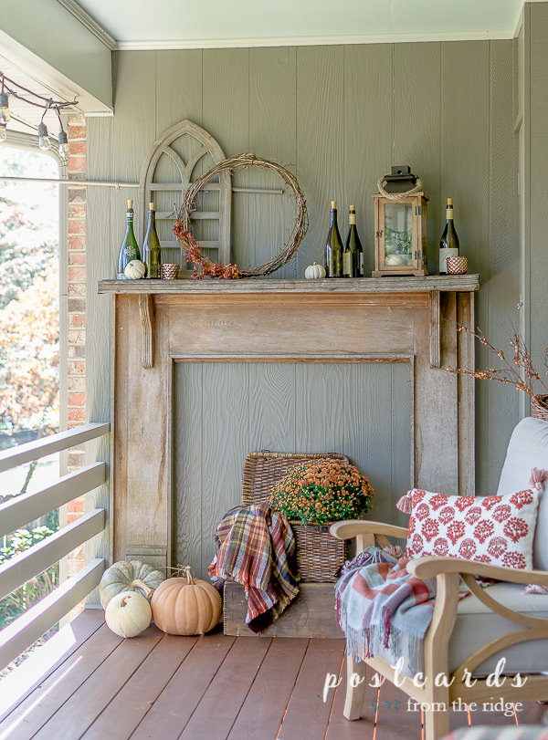 salvaged wood mantel on deck with fall decor