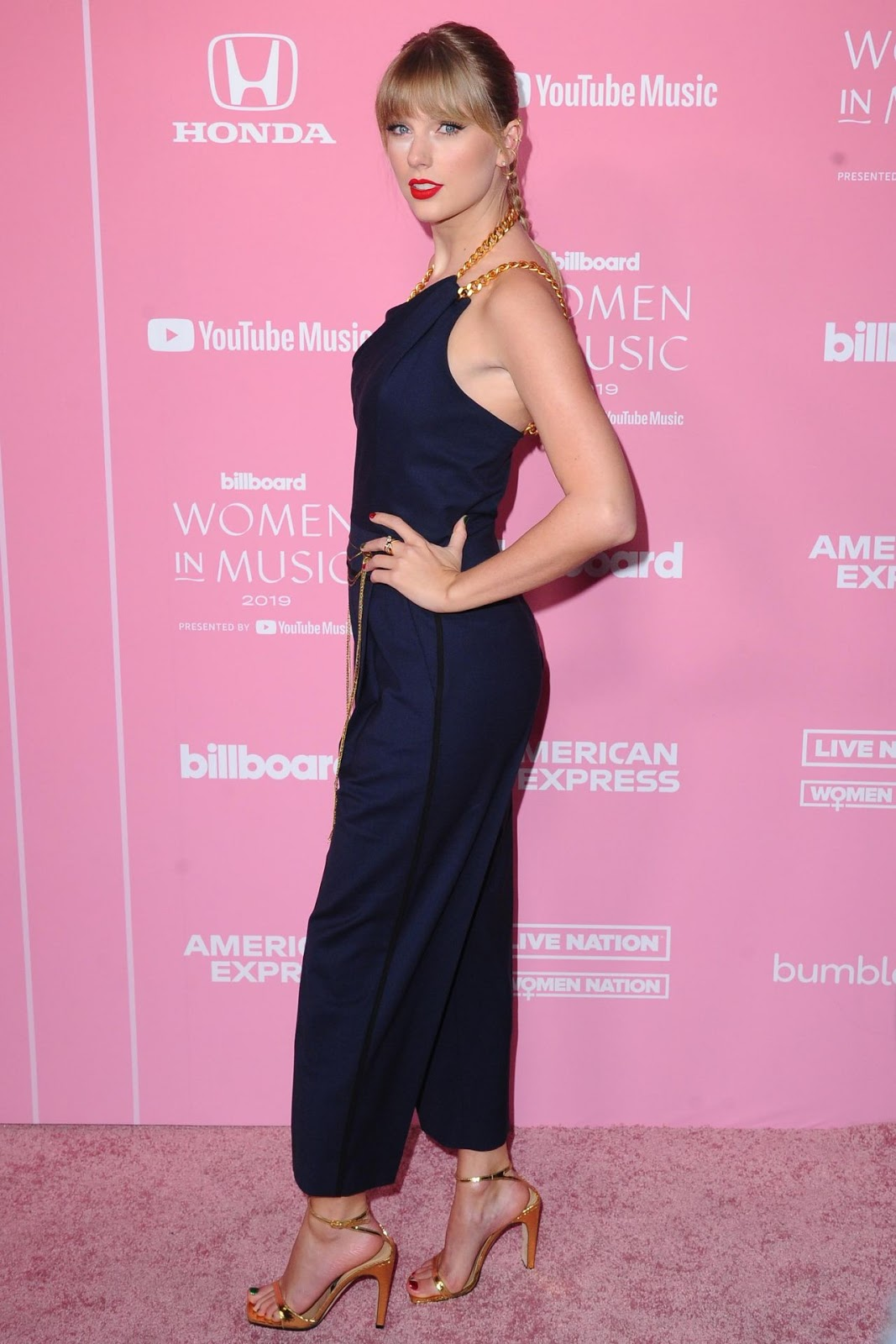 Taylor Swift goes demure in navy jumpsuit at the 2019 Billboard Women in Music event in LA