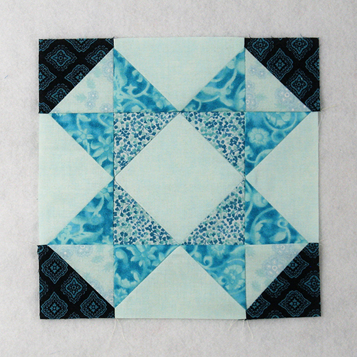 Rolling Star Quilt Block designed by Elaine Huff of Fabric406