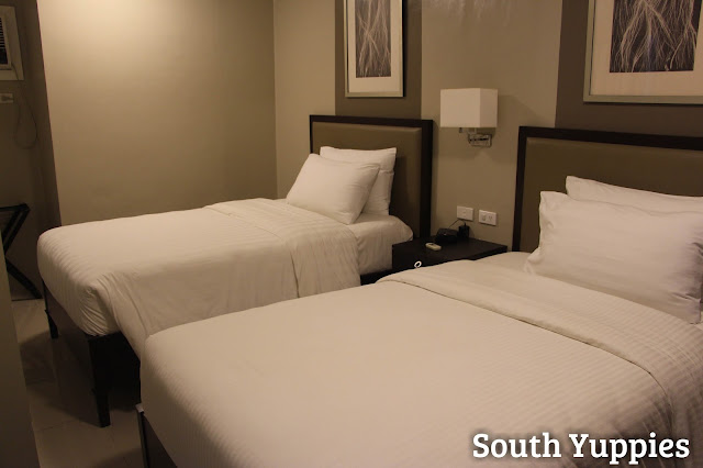 Twin beds in the second bedroom of the suite