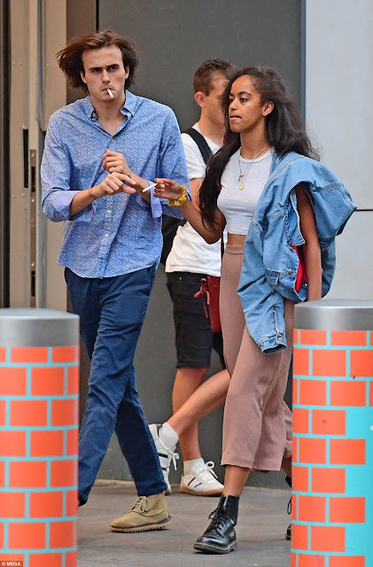 Malia Obama packs on the PDA with her white boyfriend at a London underground station