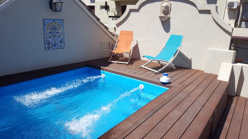 Pool terrace with jets streaming water