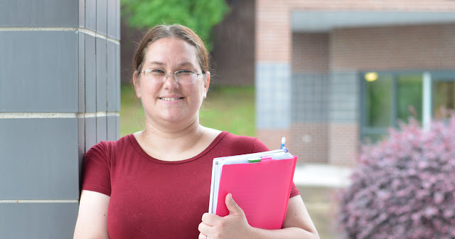 Kristen Gipson stands outside of UACCM campus building
