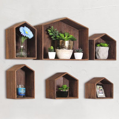 The Wooden House-Shaped Wall Storage Shelf from Nile Corp can add a rustic feel to your home